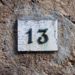 Stock Photo: Three dimensional house number thirteen