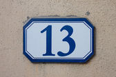 Three dimensional house number thirteen — Stock Photo