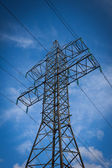 High-voltage tower sky background — Stockfoto