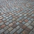 Old wet stone paved avenue street road — Stock Photo