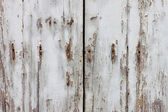 Old wooden and grungy locked door — Stock Photo