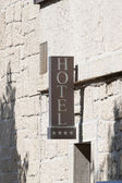 Hotel sign on the wall — Stock Photo