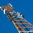 Communications tower with antenna — Stock Photo