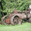 Old rusty farming tractor — Stock Photo #38357837