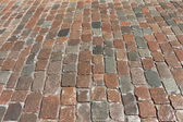 Old stone paved avenue street road — Stock Photo