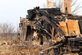 Ruins and remains of a burned down house — Stock Photo