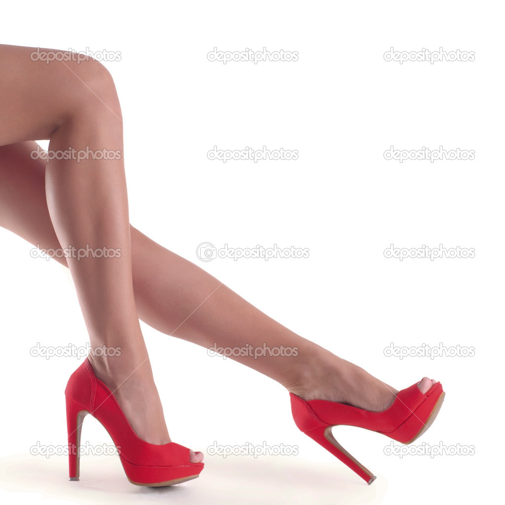 Beautiful, sexy, women s legs in red shoes on a white background