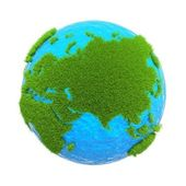 Earth located on it with the mainland from the green grass isolated on white background — Stock Photo