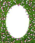 Ellipsoidische rahmen des grünen rasen mit blumen — Stockfoto