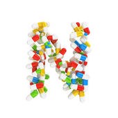 Abstract letter N consisting of pills — Stock Photo