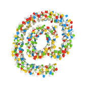 Symbol e-mail made ​​of colorful pills — Stock Photo
