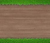 Green grass on wooden background — Photo