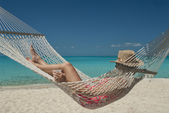 Woman in Hammock on Tropical Beach — Stock Photo