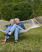 Expressive Senior Couple in Garden Hammock — Stock Photo