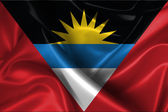 Wavy Flag of Antigua and Barbuda — Stock Photo