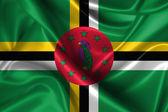 Wavy Flag of Dominica — Stock Photo