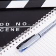Stock Photo: CinemClapper Board and Notebook