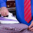 Stock Photo: Businessman Ironing Clothes