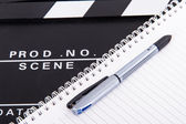 Kino clapper board und notebook — Stockfoto