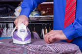 Businessman Ironing Clothes — Stock Photo