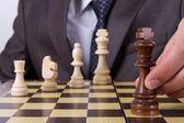 Businessman Holding Chess Piece — Stockfoto