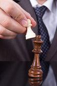 Businessman Holding Pawn Against King — Foto de Stock