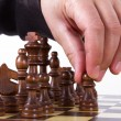 Hand Moving Pawn One Step Forward — Stock Photo
