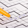 Stock Photo: Blank Crossword Puzzle with Pen and Profit Text