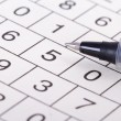 Stock Photo: Crossword Puzzle with Numbers and Black Pen