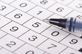 Crossword Puzzle with Numbers and Black Pen — ストック写真