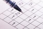 ペンと数字パズルします。 — ストック写真