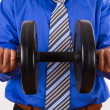 Businessman Raising Dumbbell — Stock Photo