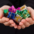 Hands Extend Gift Box — Stock Photo