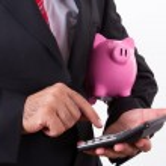 Man Holding Piggy Bank and Calculator — Stock Photo #30473449