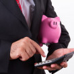 Man Holding Piggy Bank and Calculator — Stock Photo