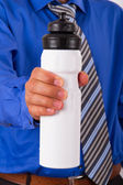 Businessman Showing Sport Water Bottle — Stockfoto