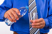 Water Bottle and Glass with Businessman — Stock Photo