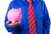 Businessman Holding Pink Piggy Bank — Stock Photo