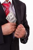 Man Putting Money into Pocket — Stock Photo