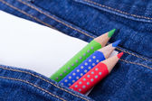 Colorful Pencils and Blank Paper in Pocket — Stock Photo