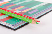 Red and Green Pencils on Art Book — Stock Photo