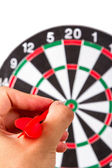 Hand Holding Arrow and Throwing Dart Board — Stock Photo