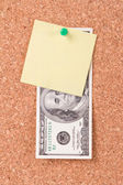Dollar Bill and Sticky Post on Cork Board — Stock Photo