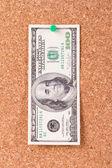 Dollar Bill on Cork Board — Stock Photo