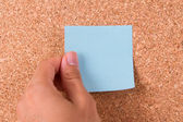 Hand and Sticky Post It Note — Stock Photo