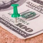 Push Pin and Dollar Bill on Cork Board — Stock Photo