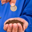 Businessman Holding Soil and Coin — Foto de Stock