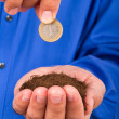 Businessman Holding Soil and Coin — Stockfoto