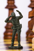 Miniature Toy Soldier on Chess Board — Stock Photo