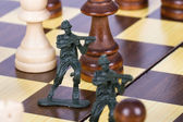 Miniature Toy Soldiers on Chess Board — Stock Photo